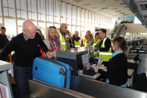 Prestwick Airport Disability Access Day. The group has the baggage check in process explained to them.