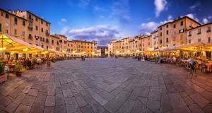 Famous Piazza Anfiteatro in Lucca, Italy on 13 September, 2017. The square is a public square in the northeast quadrant of walled center of Lucca, Italy. - editorial use only