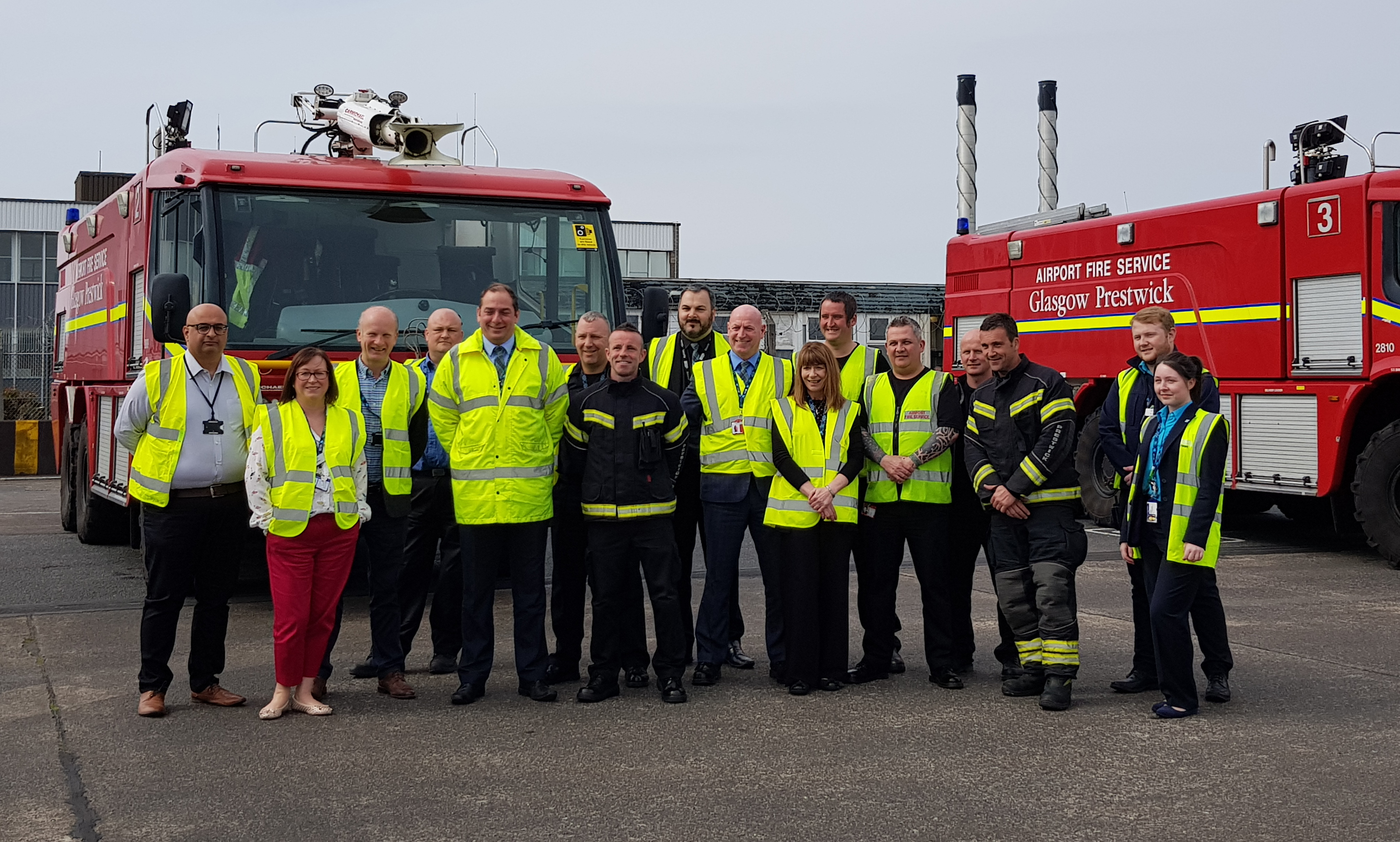 staff members infront of a fire tender.